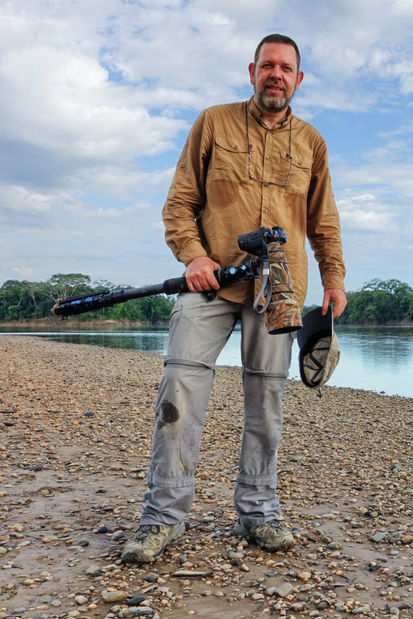 Dirk Beckers standing on the banks of the Guayabero river in La Macarena, Colombia.